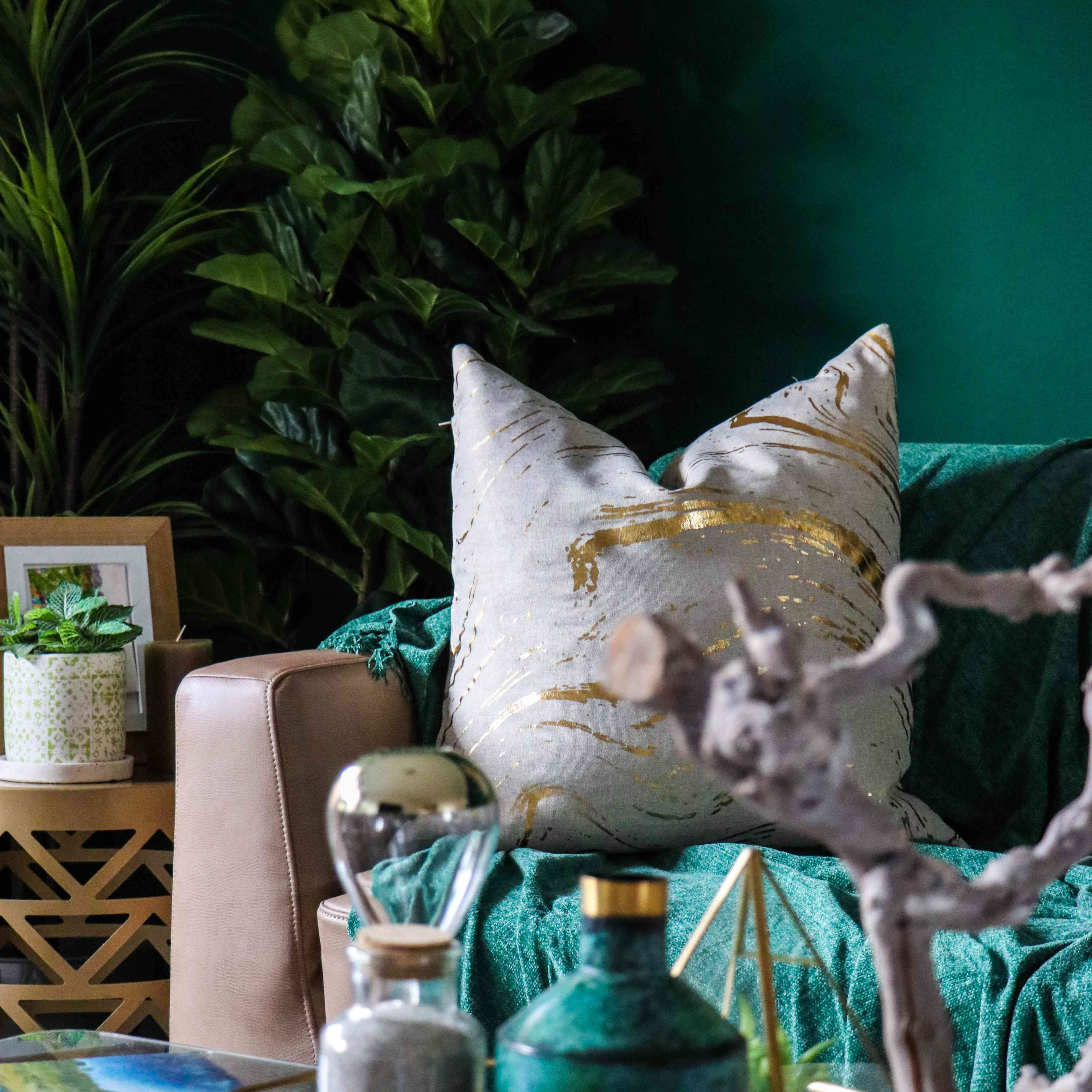 green and teal toned room with lush green plants