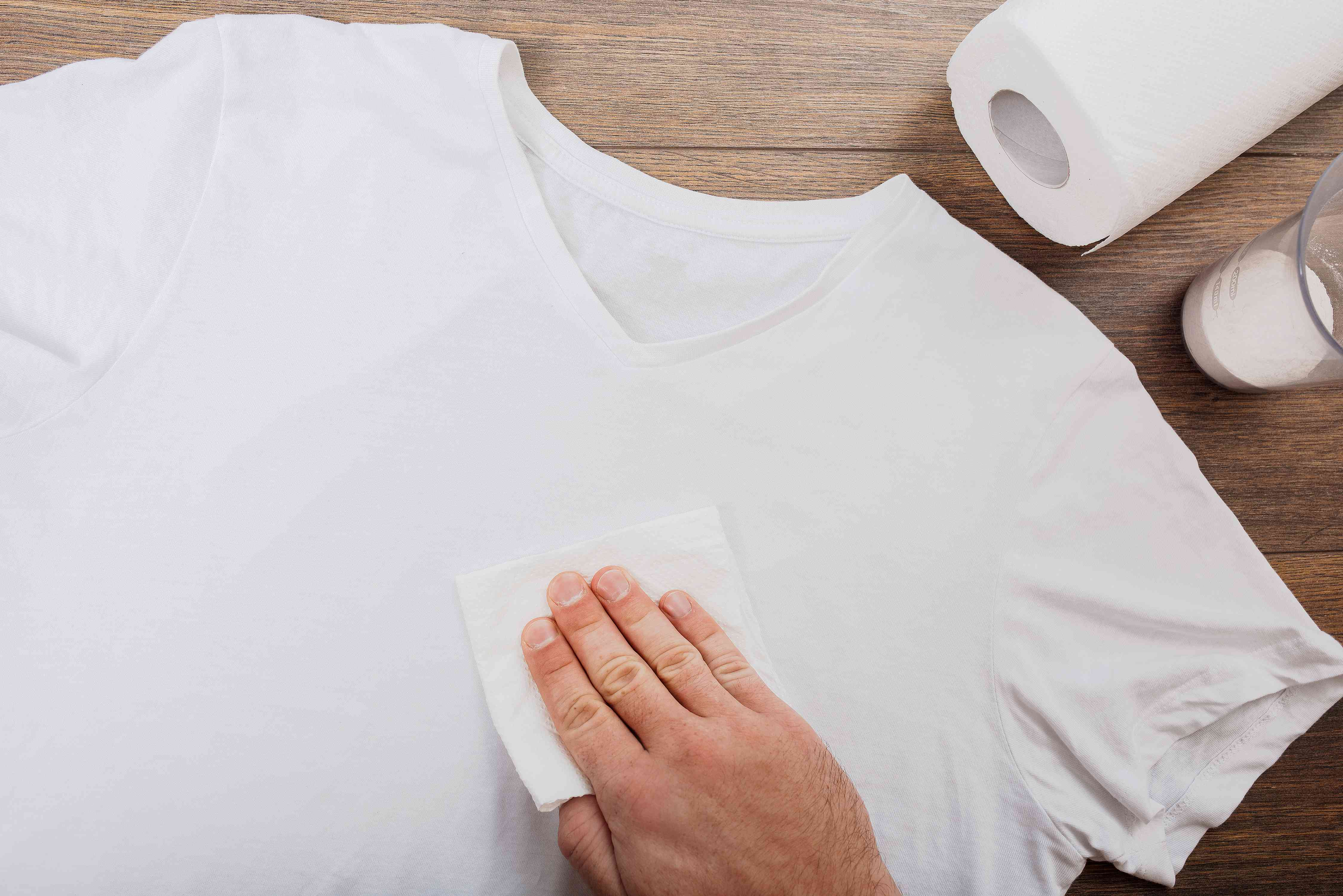 blotting a tshirt to pretreat a stain