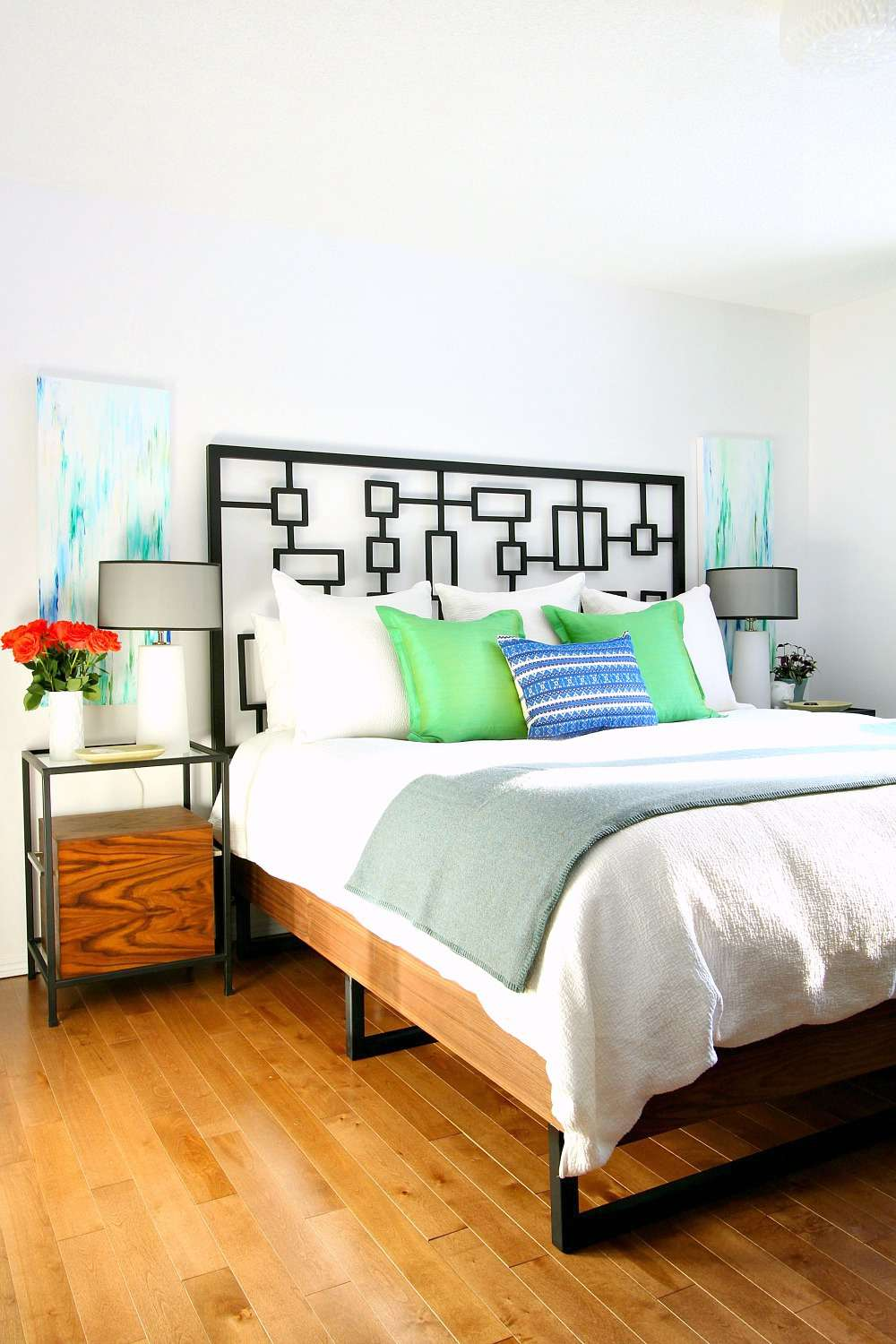 A wood and iron bed in a bedroom