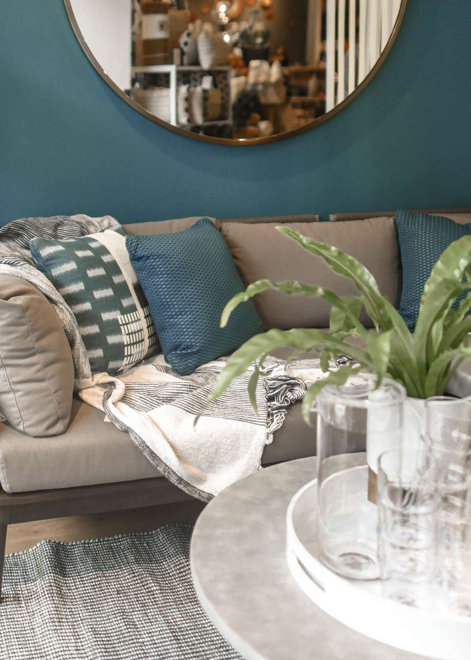 living room with blue and gray tones and a plant