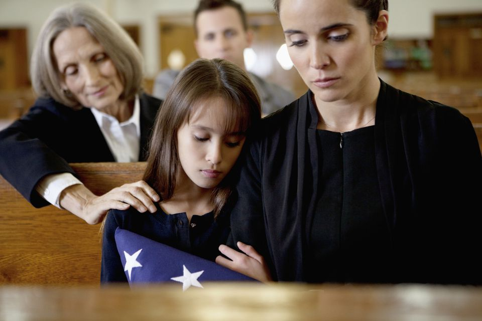 women and child at a funeral