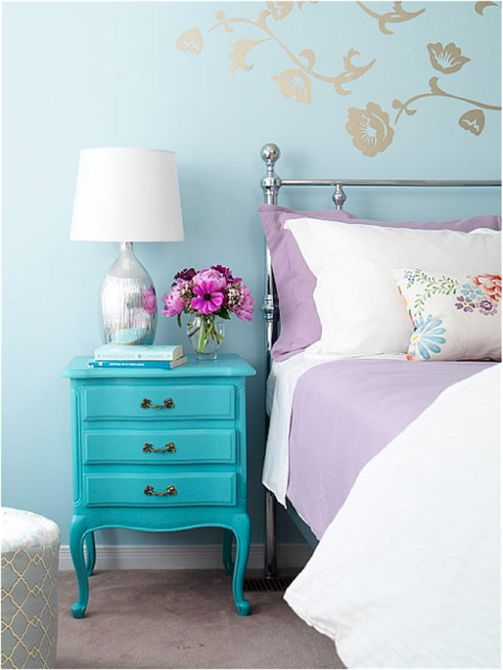 Turquoise dresser in a vintage bedroom