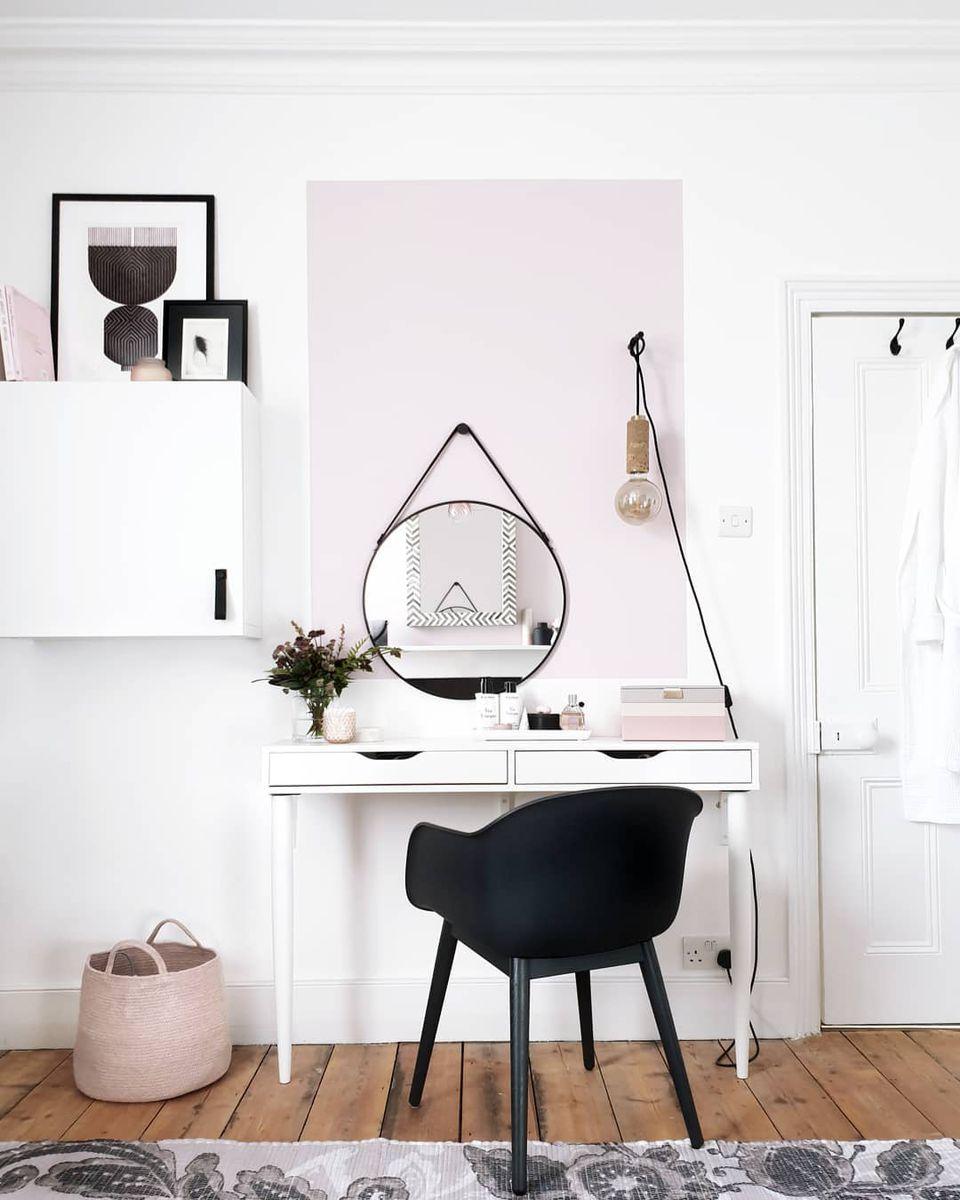 Desk with a pink basket under