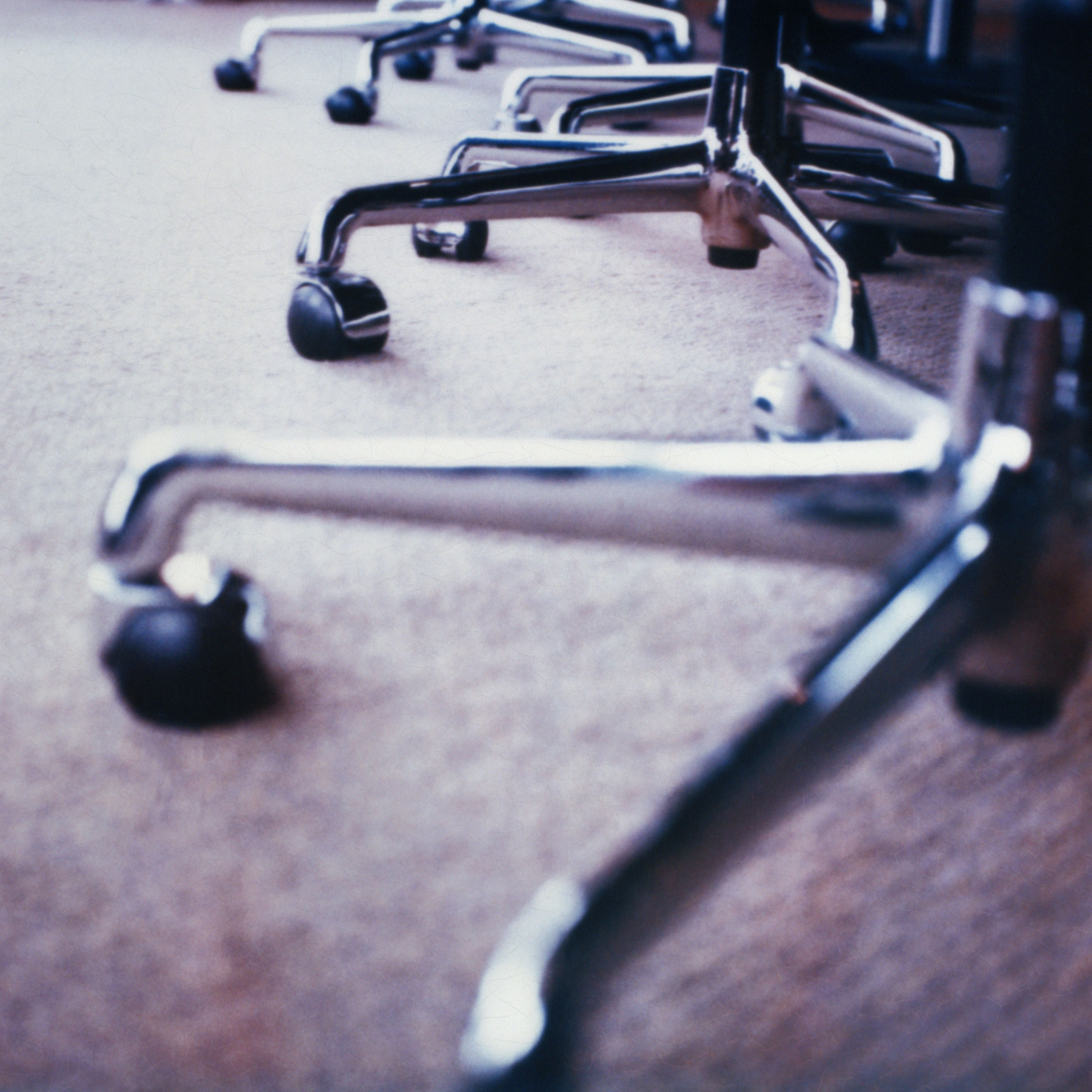 A set of office chairs with castors.
