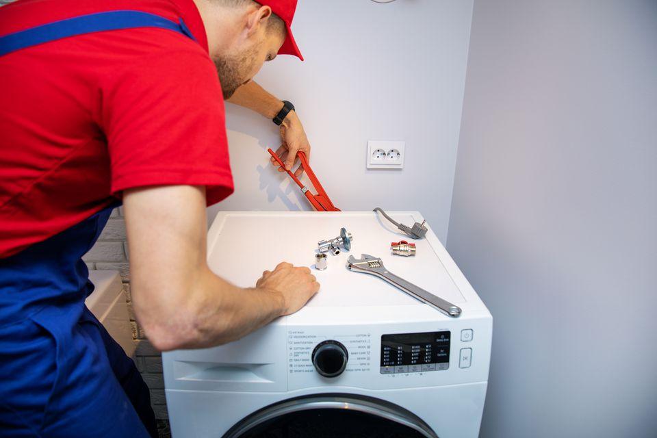 Man installing washer machine
