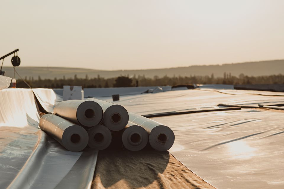 Roofing PVC membrane in rolls placed on the roof of a hall