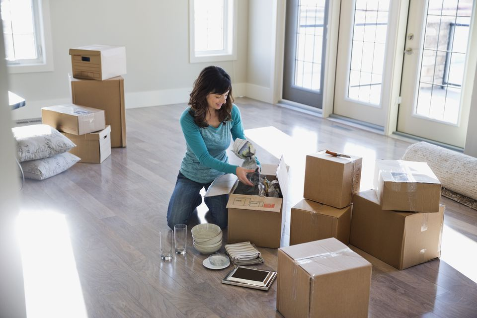 Woman surrounded by moving boxes