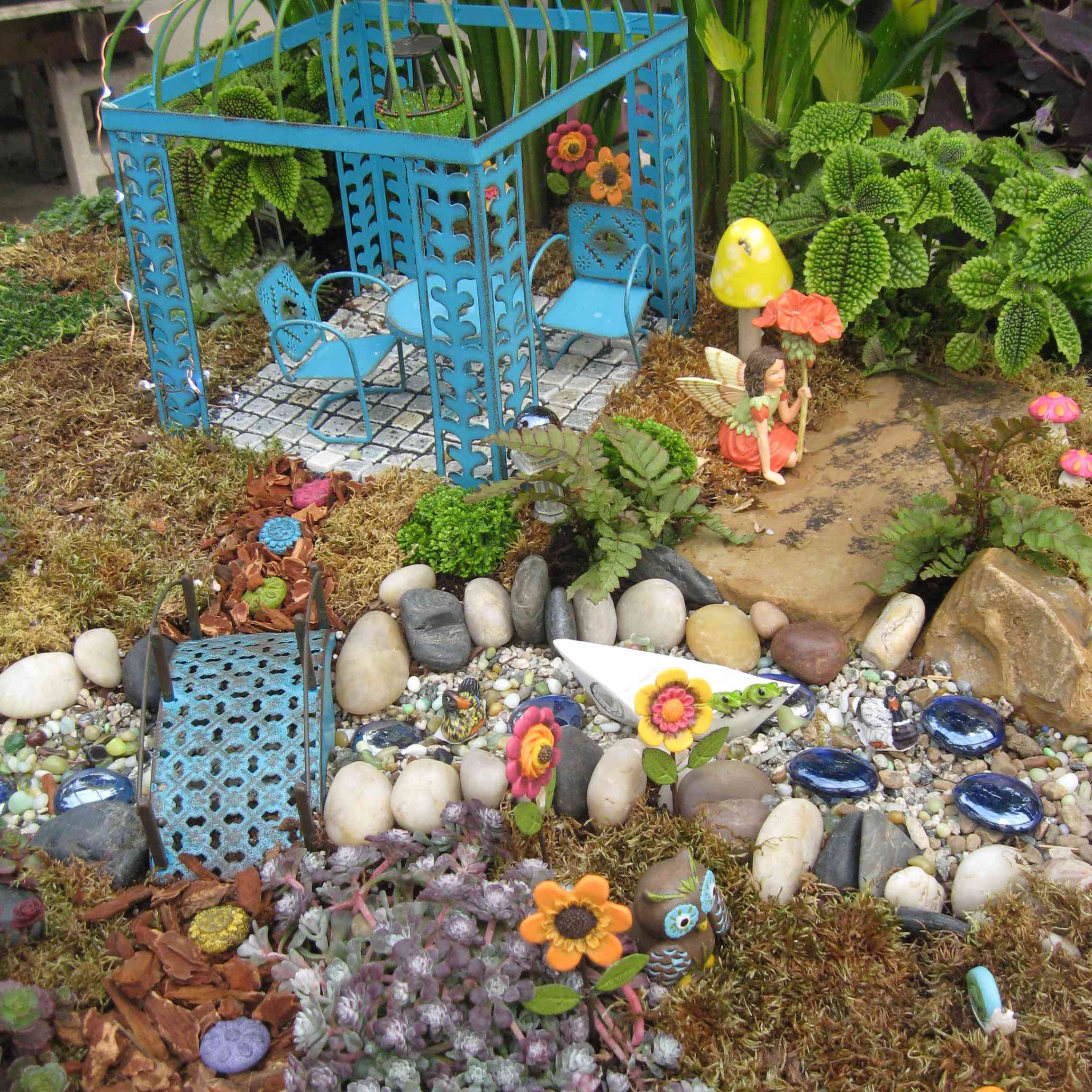 Miniature furniture in a fairy garden.