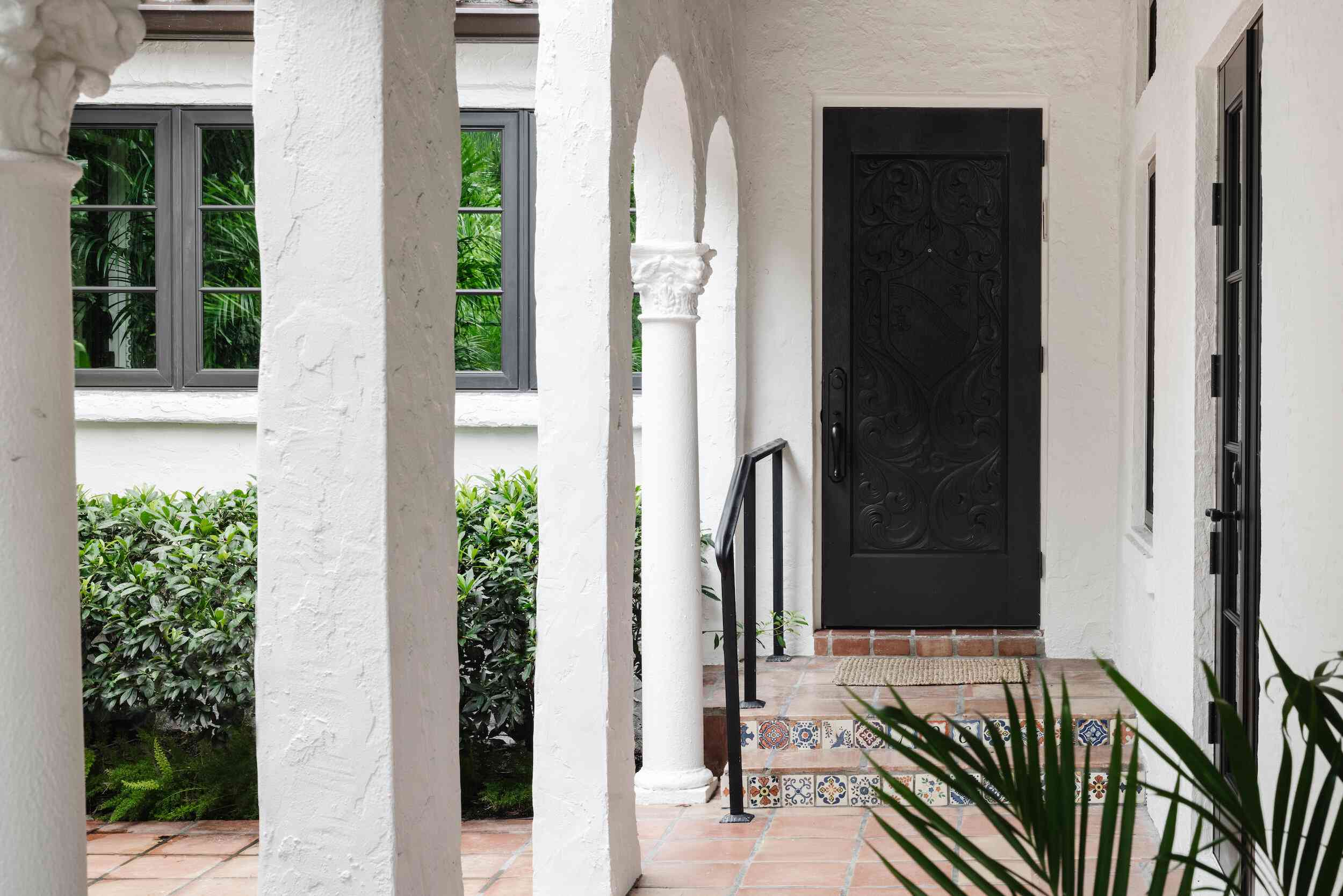 front entryway with columns and tile walkway