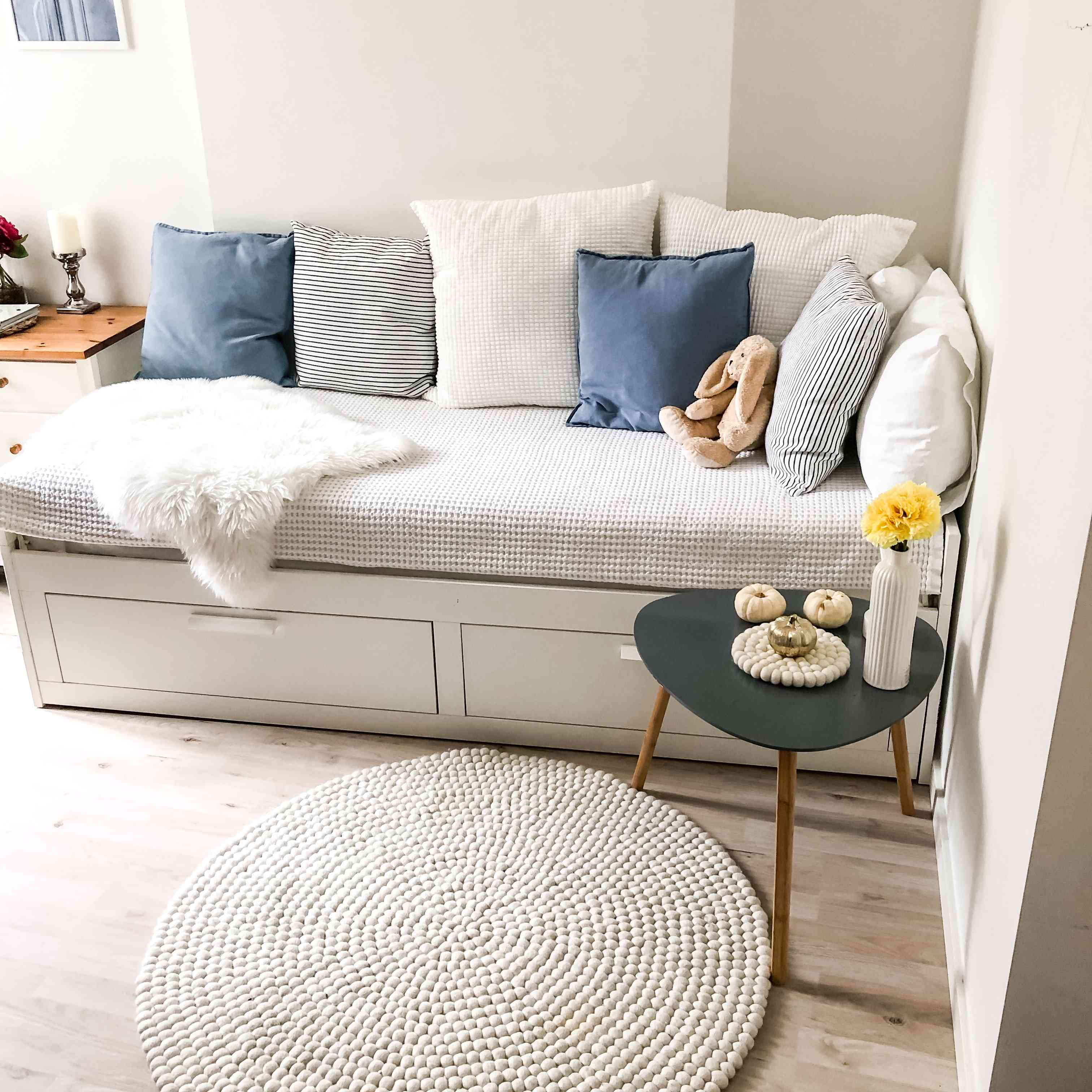 cozy living room built in with white and blue accents