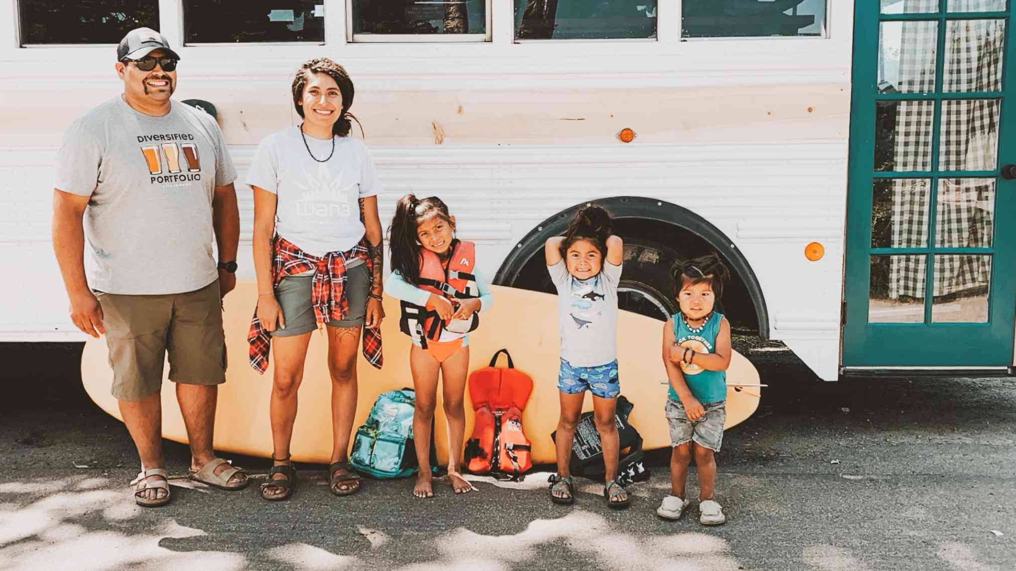 family with tiny home skoolie