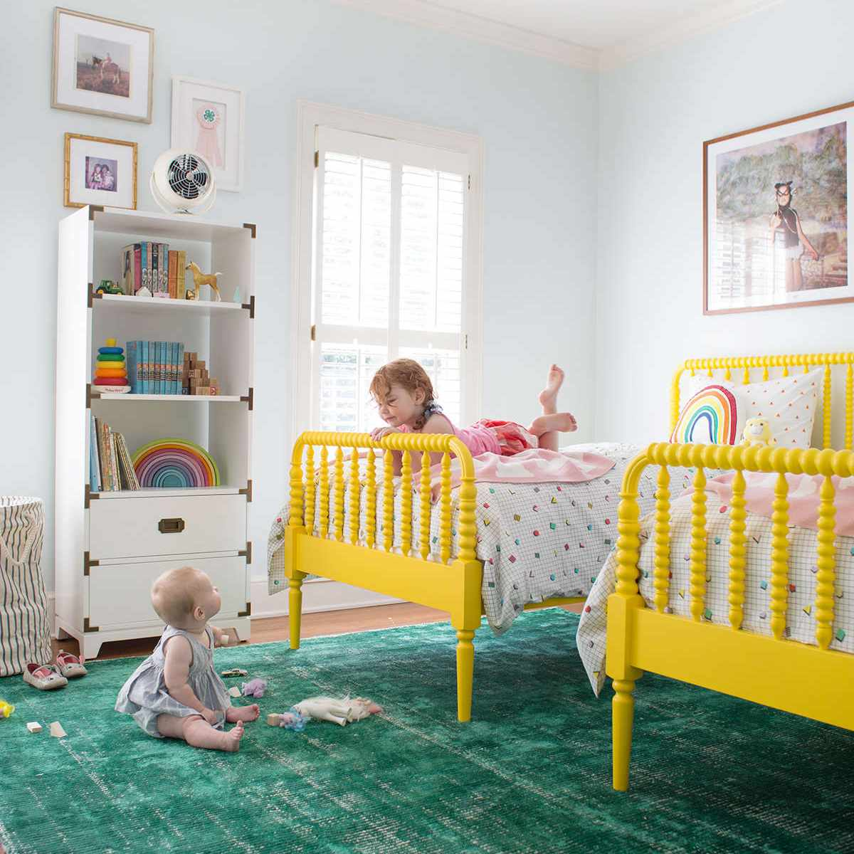 Rainbow-themed girl's room with green and yellow accents