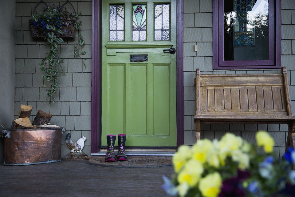 A home with a green painted door and purple trim