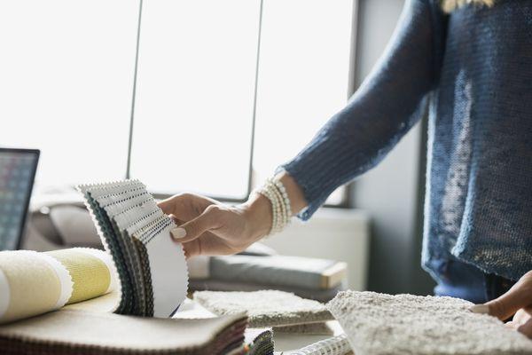 Interior designer examining carpet swatches