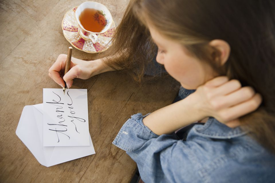 Woman writing thank you card