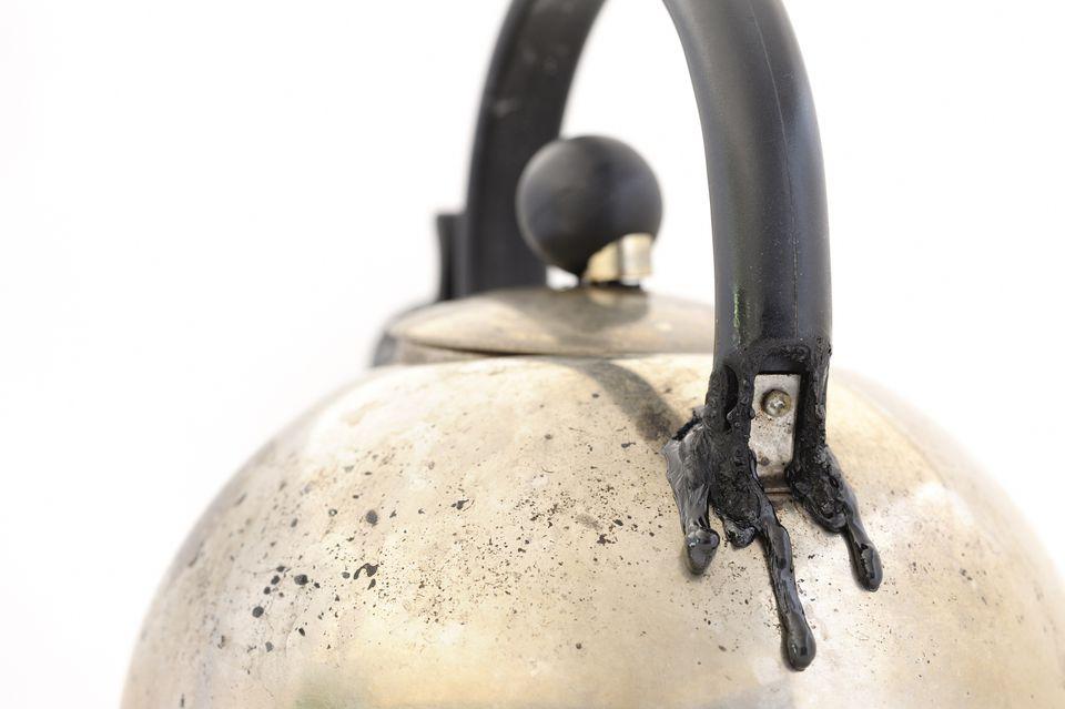 Melted black handle on silver tea kettle