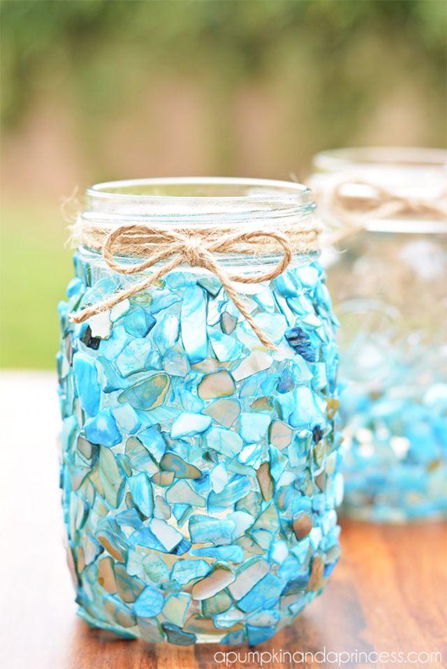 A mason jar decorated in sea glass