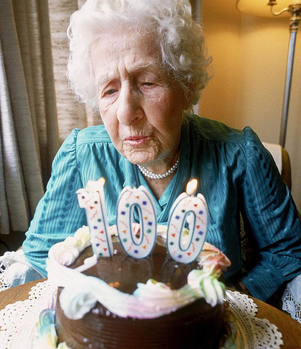 Old woman Blowing Out Candles