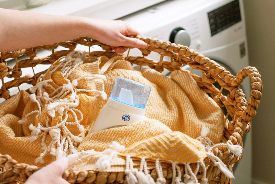 high efficiency laundry detergent in a hamper