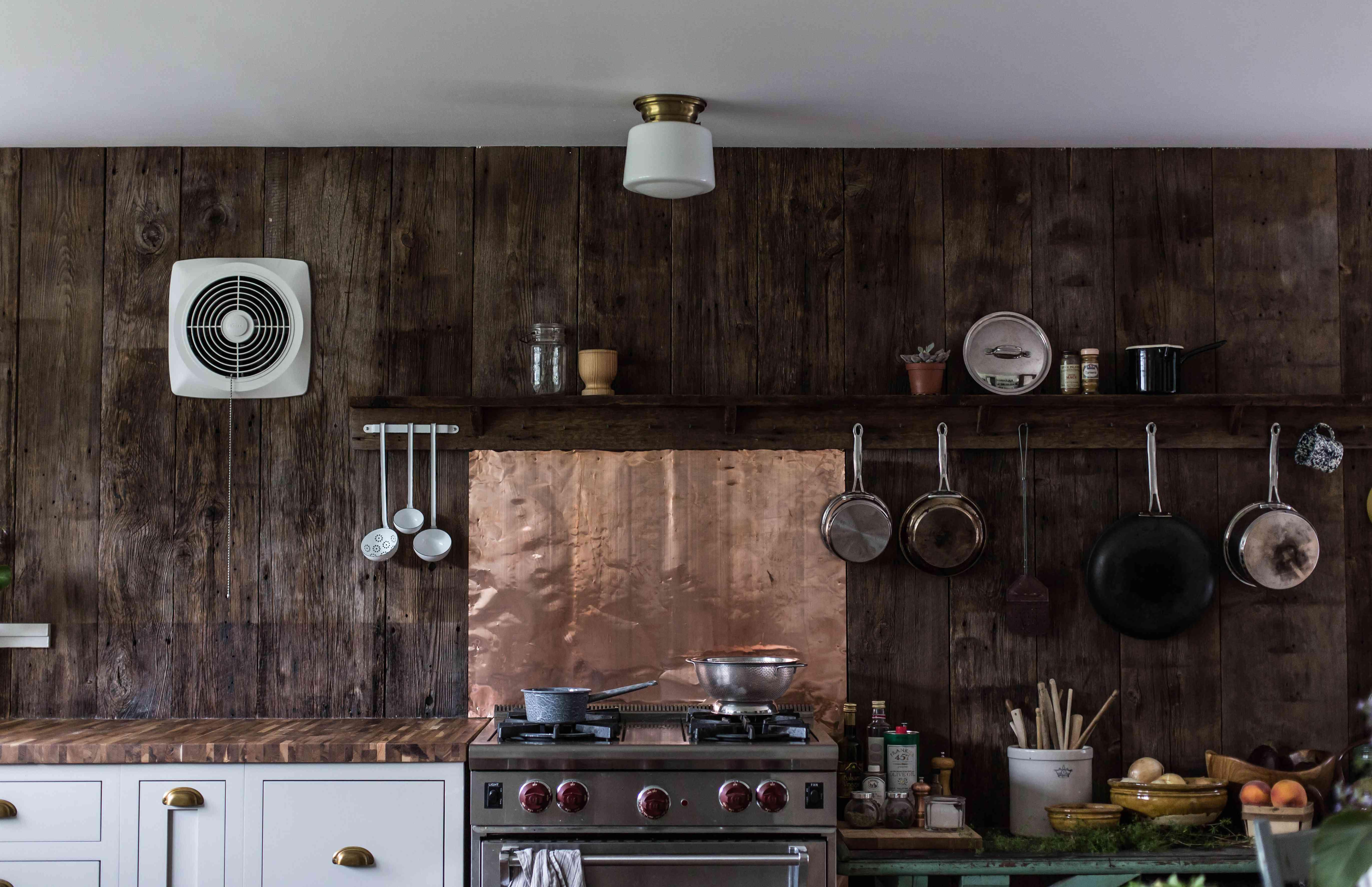 Copper backsplash in a rustic kitchen.