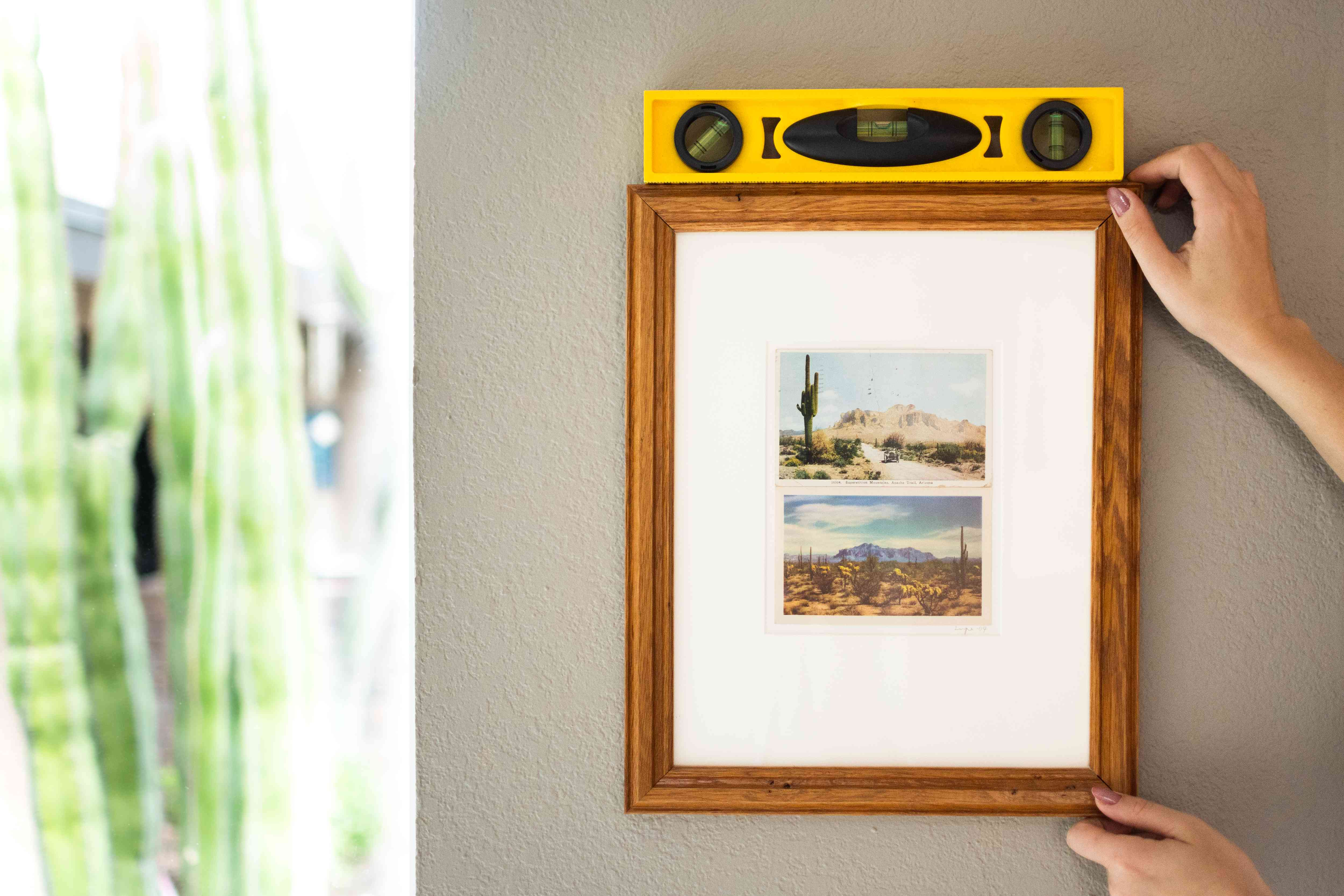 Picture frame placed on wall with yellow level on top