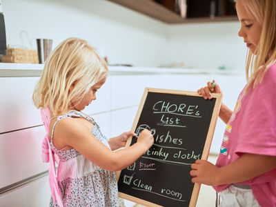 Sisters creating a chore list