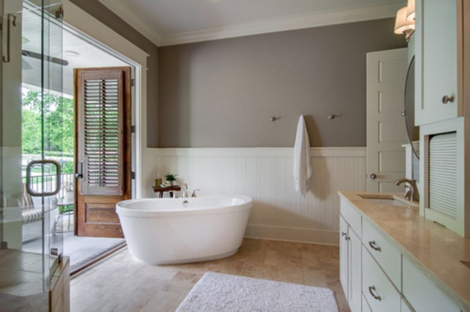 Gray and Taupe bathroom with wainscoating