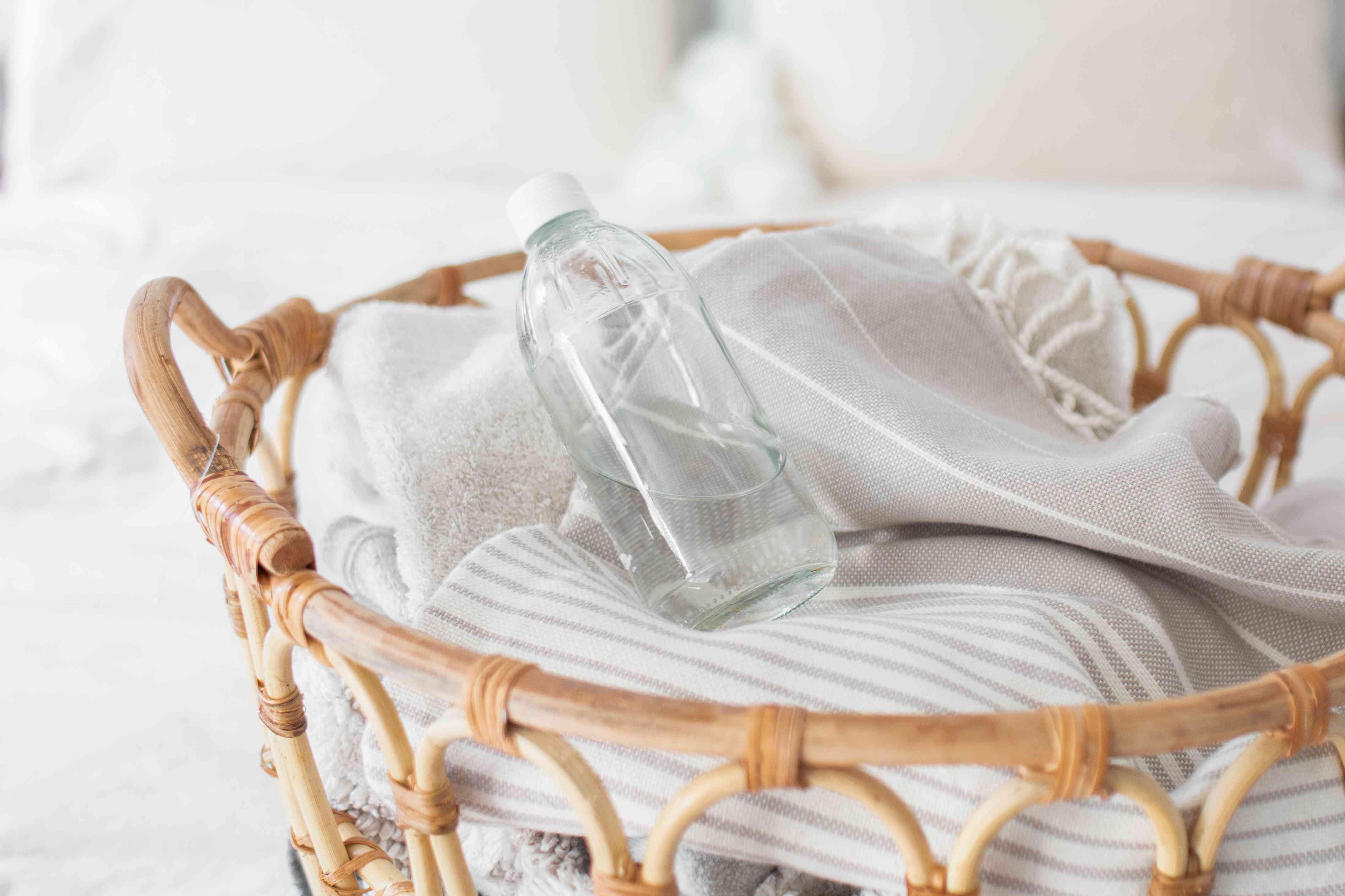 distilled white vinegar in a laundry basket