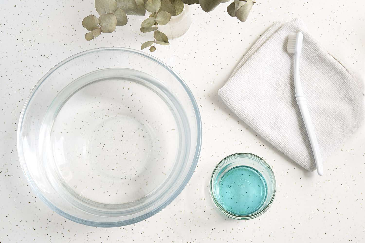 Items for cleaning a straw handbag