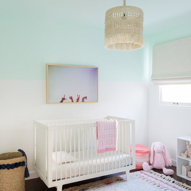 Pastel-drenched beach-themed nursery with ombre effect walls