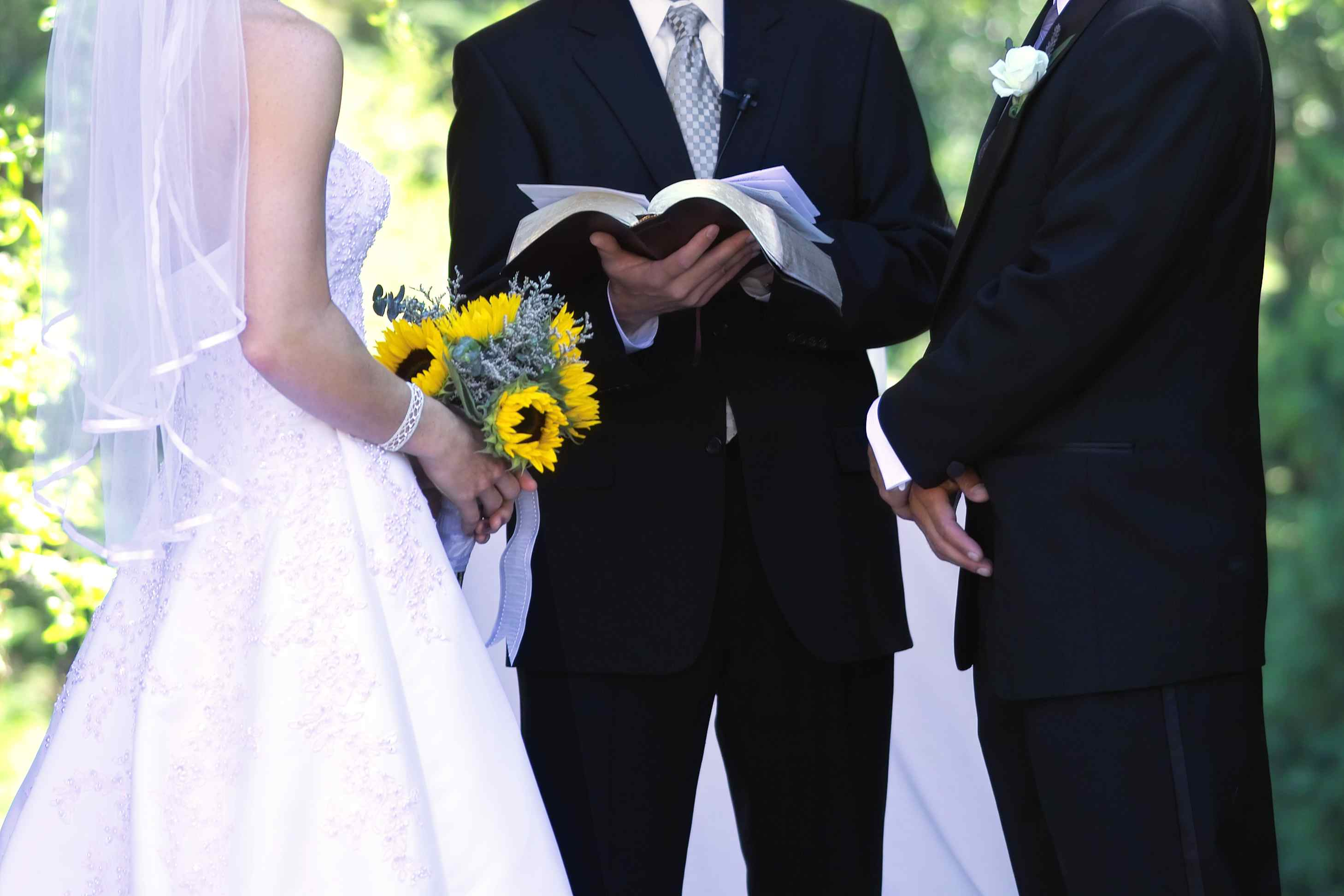 Bride with sunflower bouquet at the altar