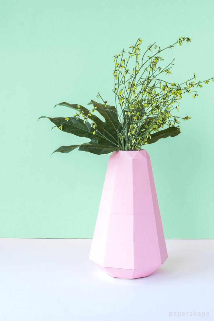 A pink vase made out of paper