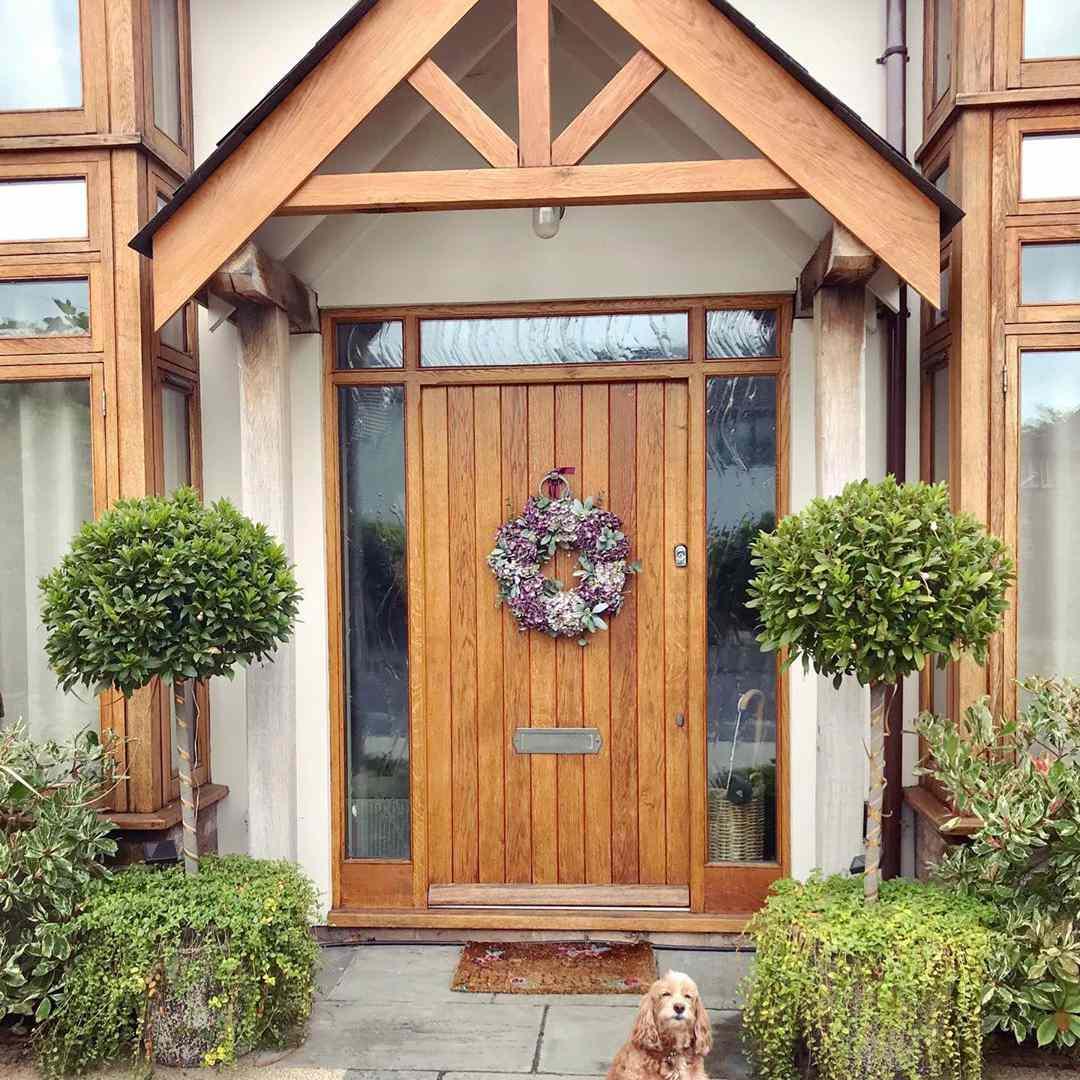 Front door with wood paneling
