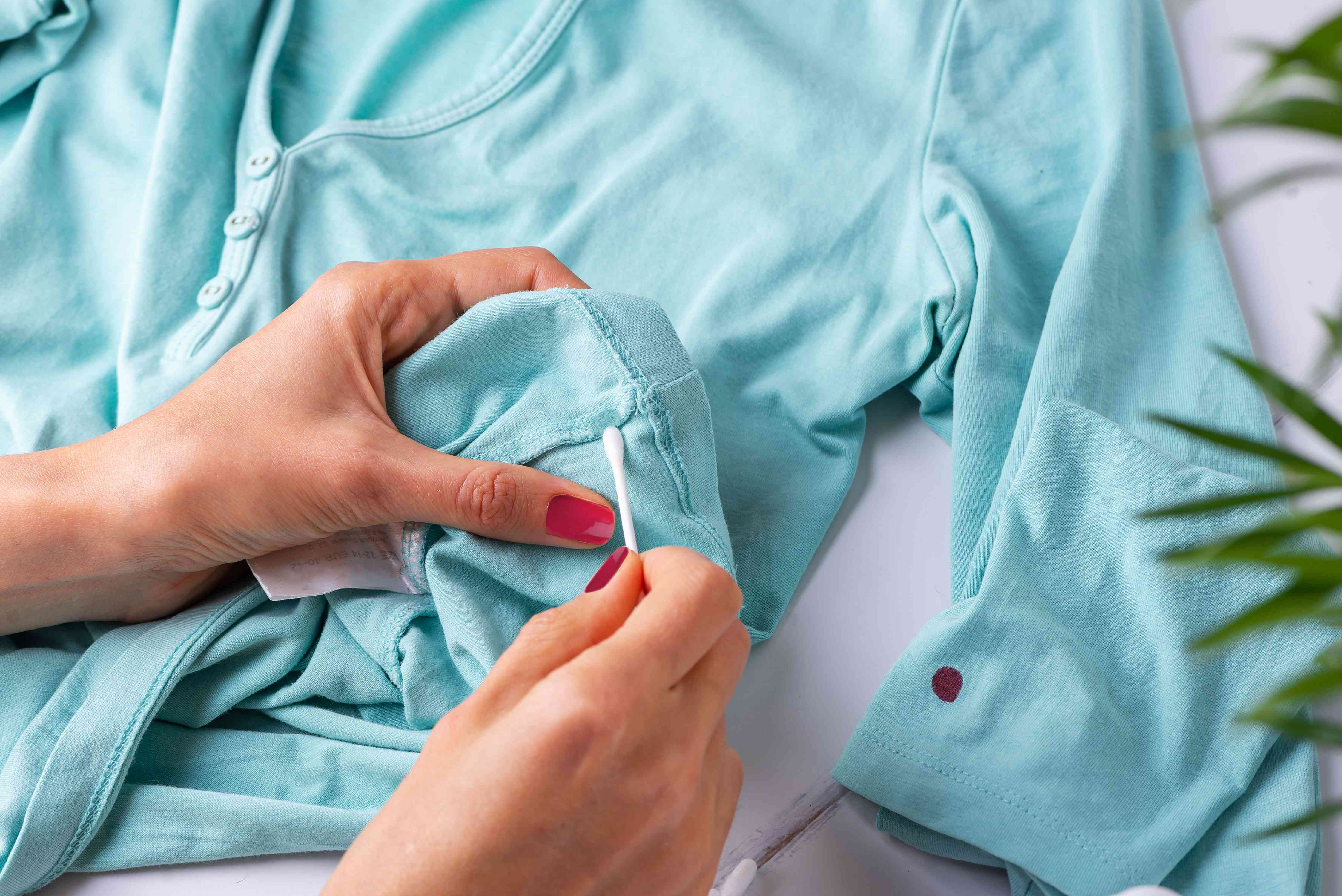 testing nail polish remover on a hidden area of the garment