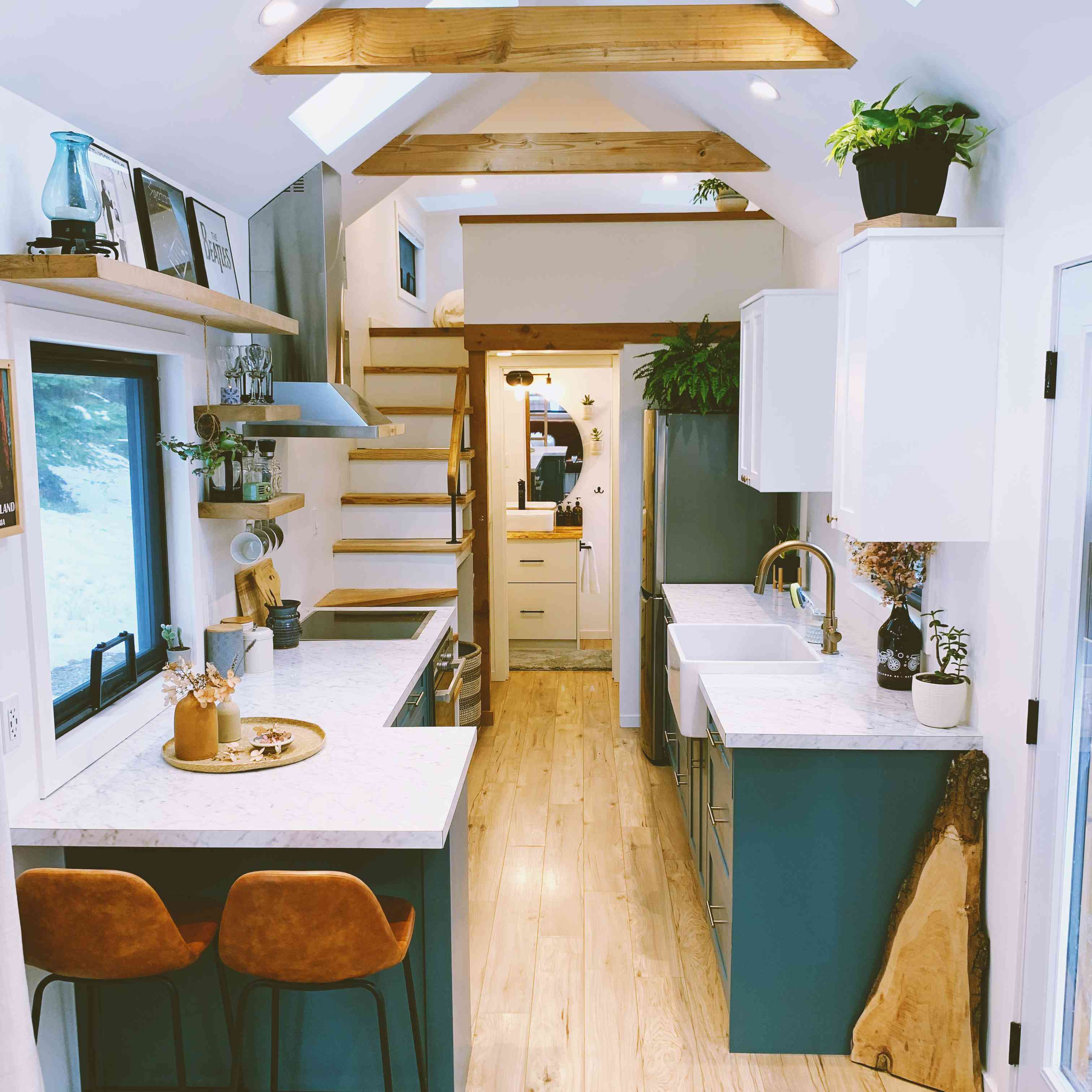 tiny home kitchen with skylights and two-tone cabinets
