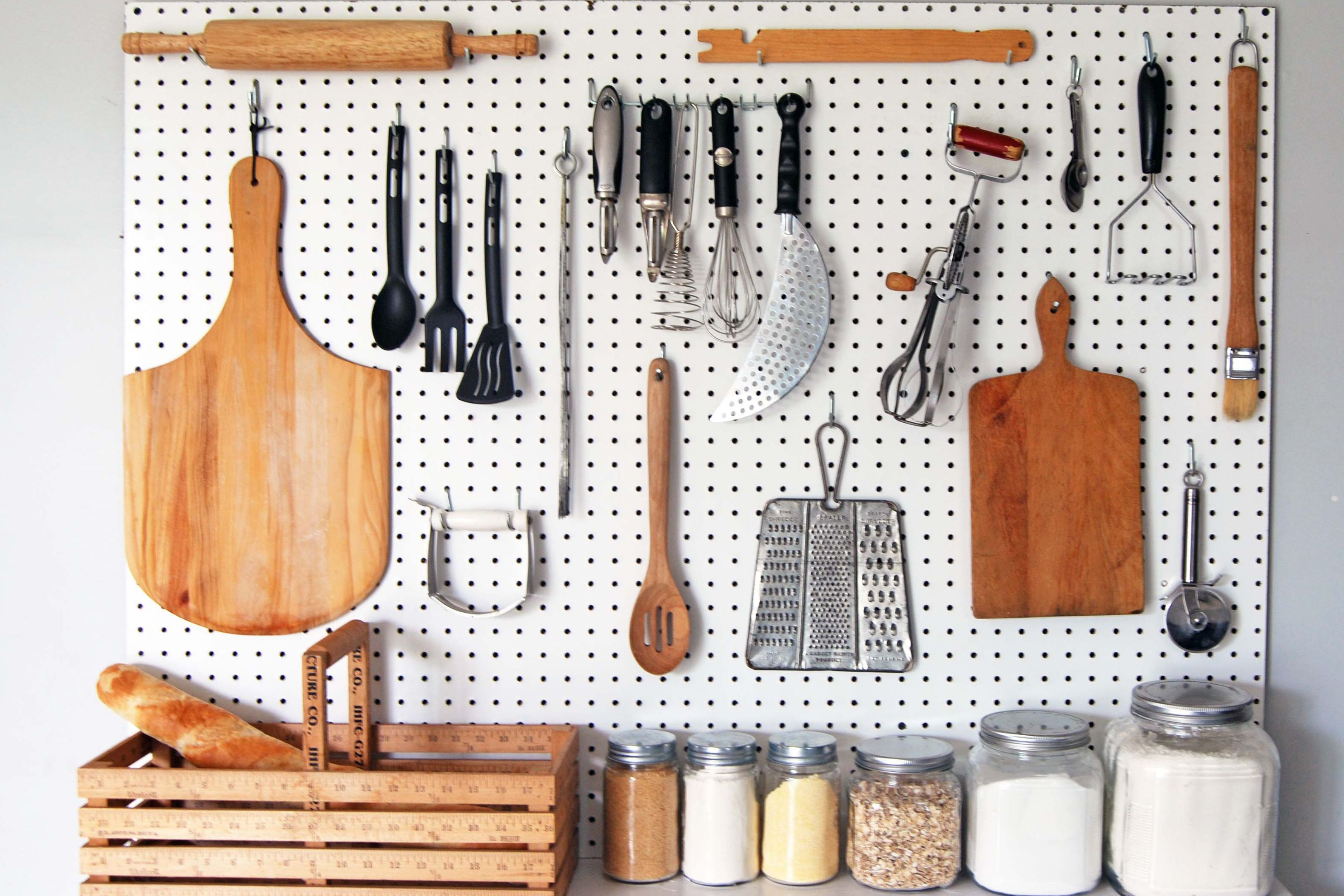 Kitchen pegboard with kitchen items hanging on it