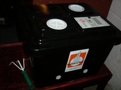 A plastic worm bin