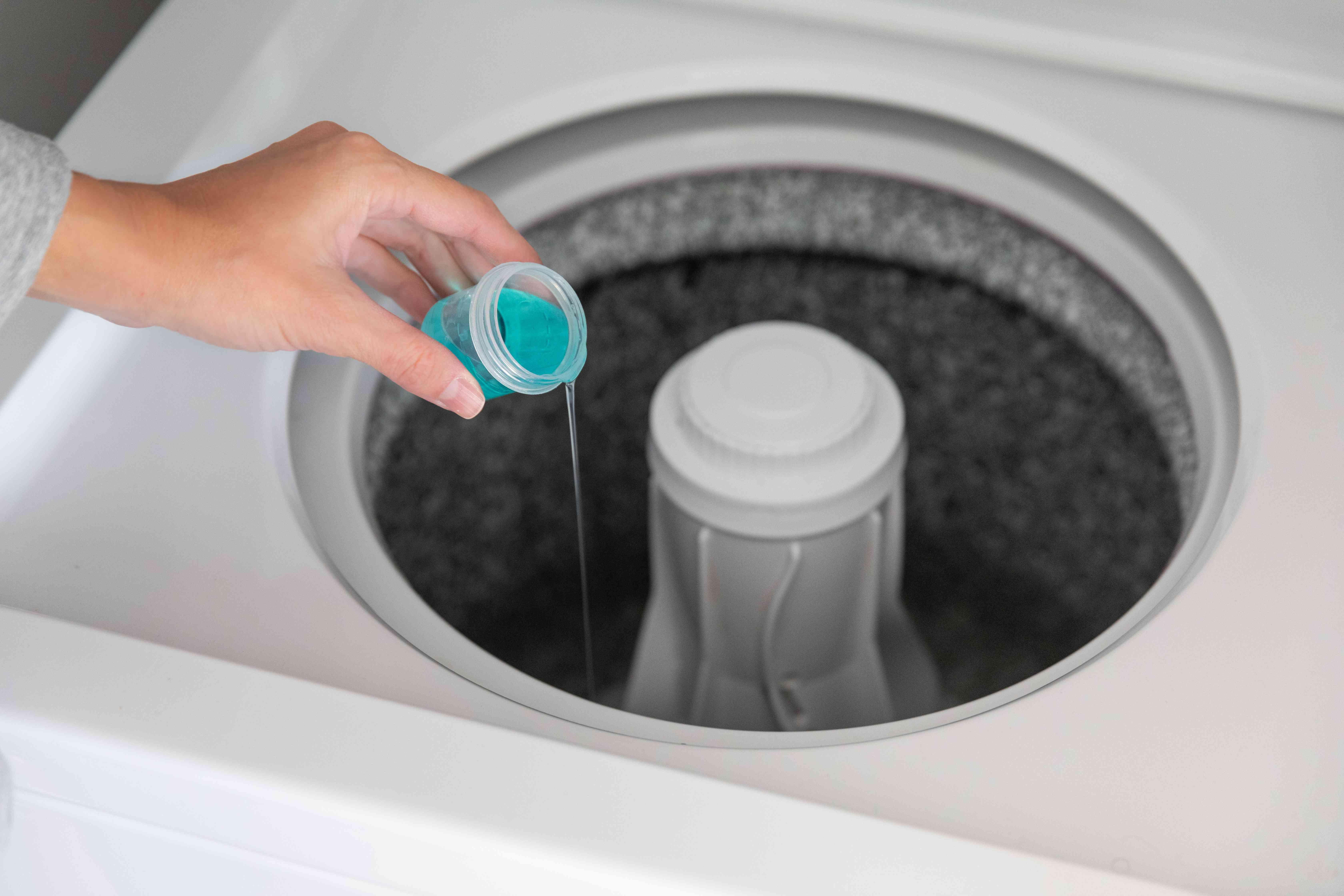 adding detergent to an empty washer drum