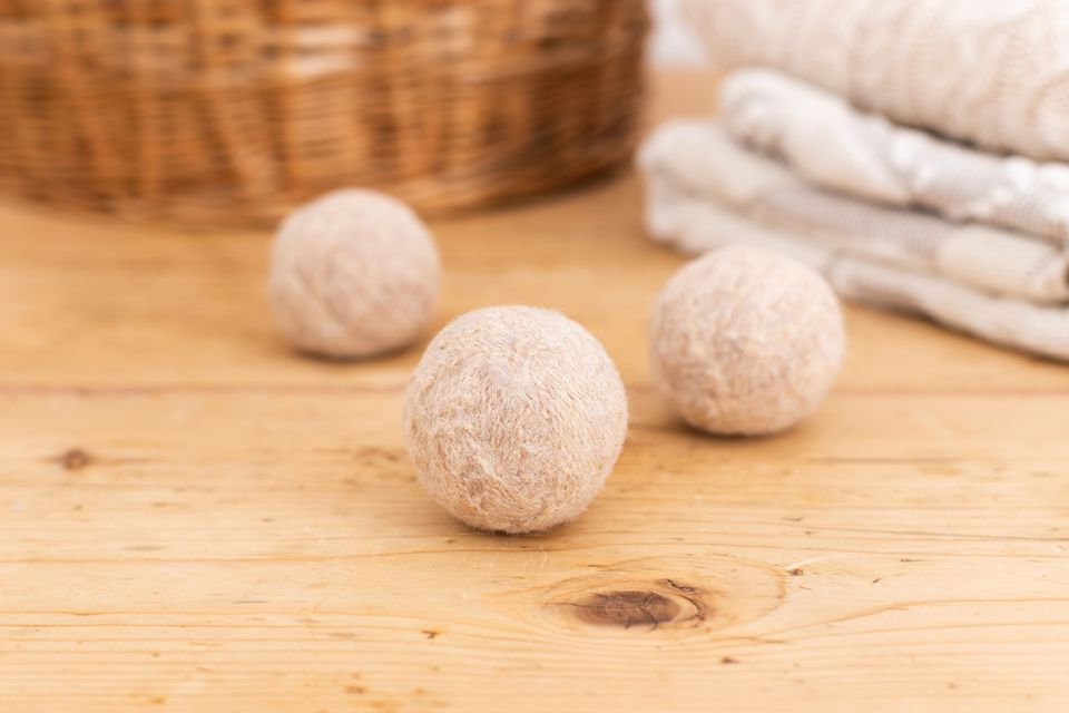 Homemade dryer balls on wooden surface