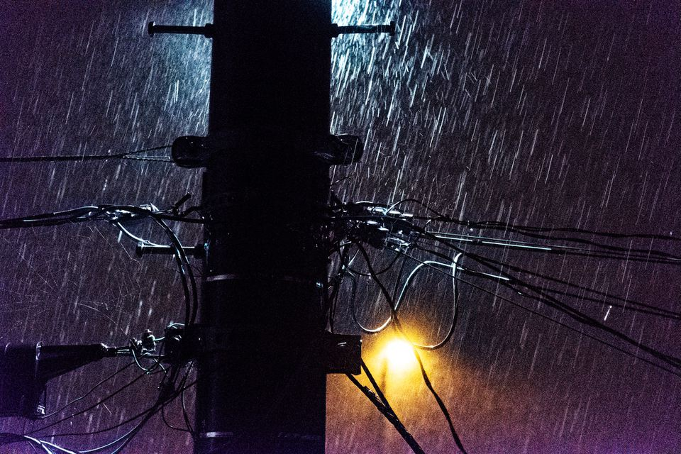 power lines in the rain at night
