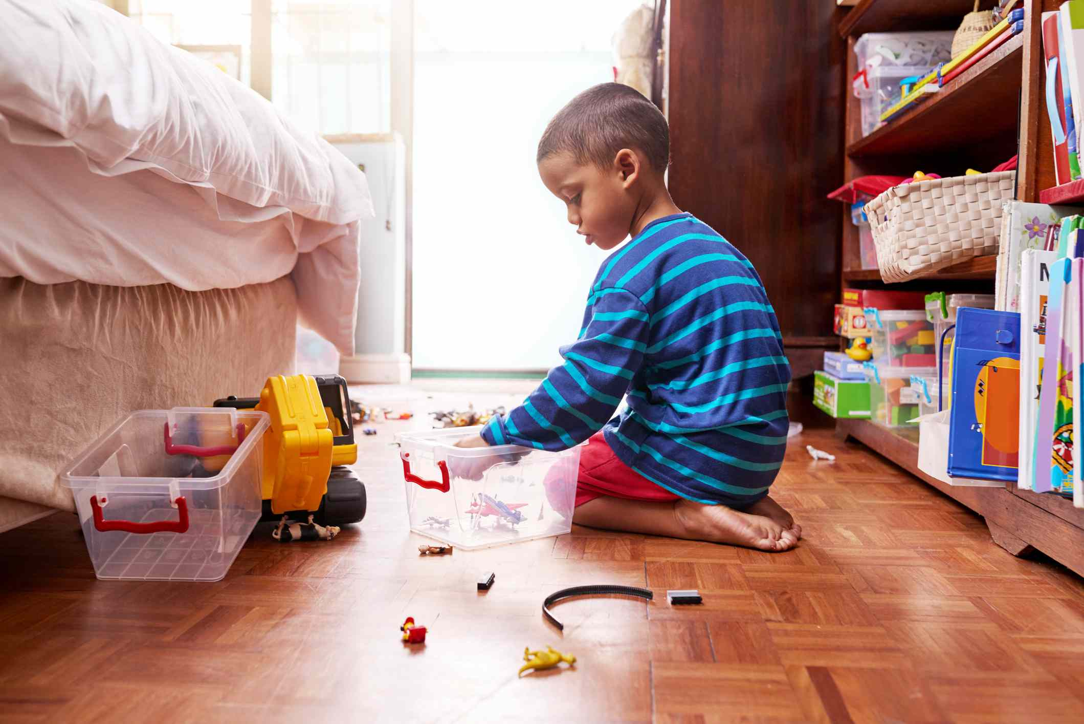 Kid cleaning his room