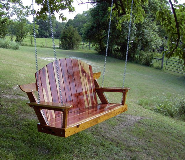 A Porch Swing In Large Yard