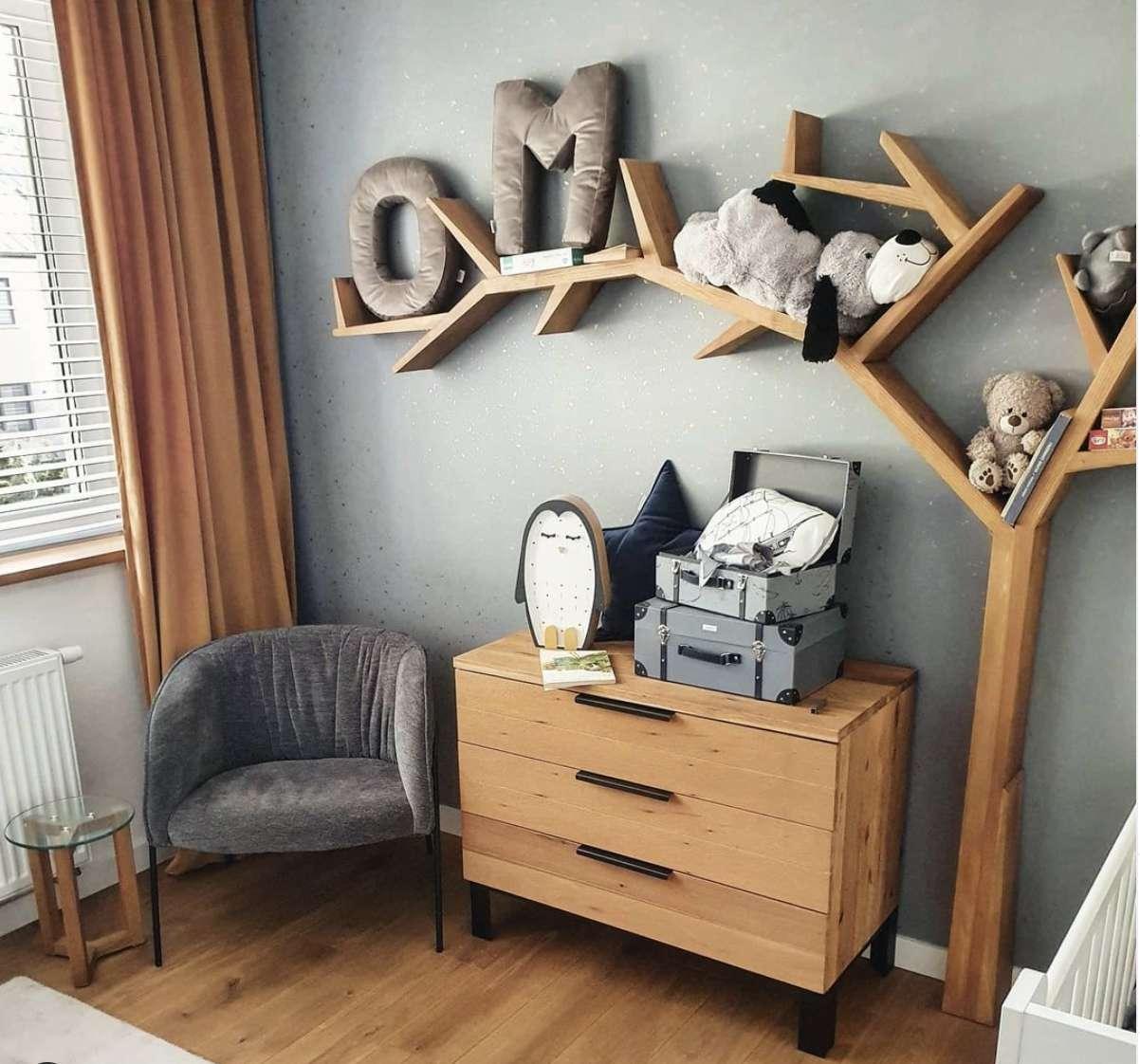 gray nursery with wooden furniture tree shelf