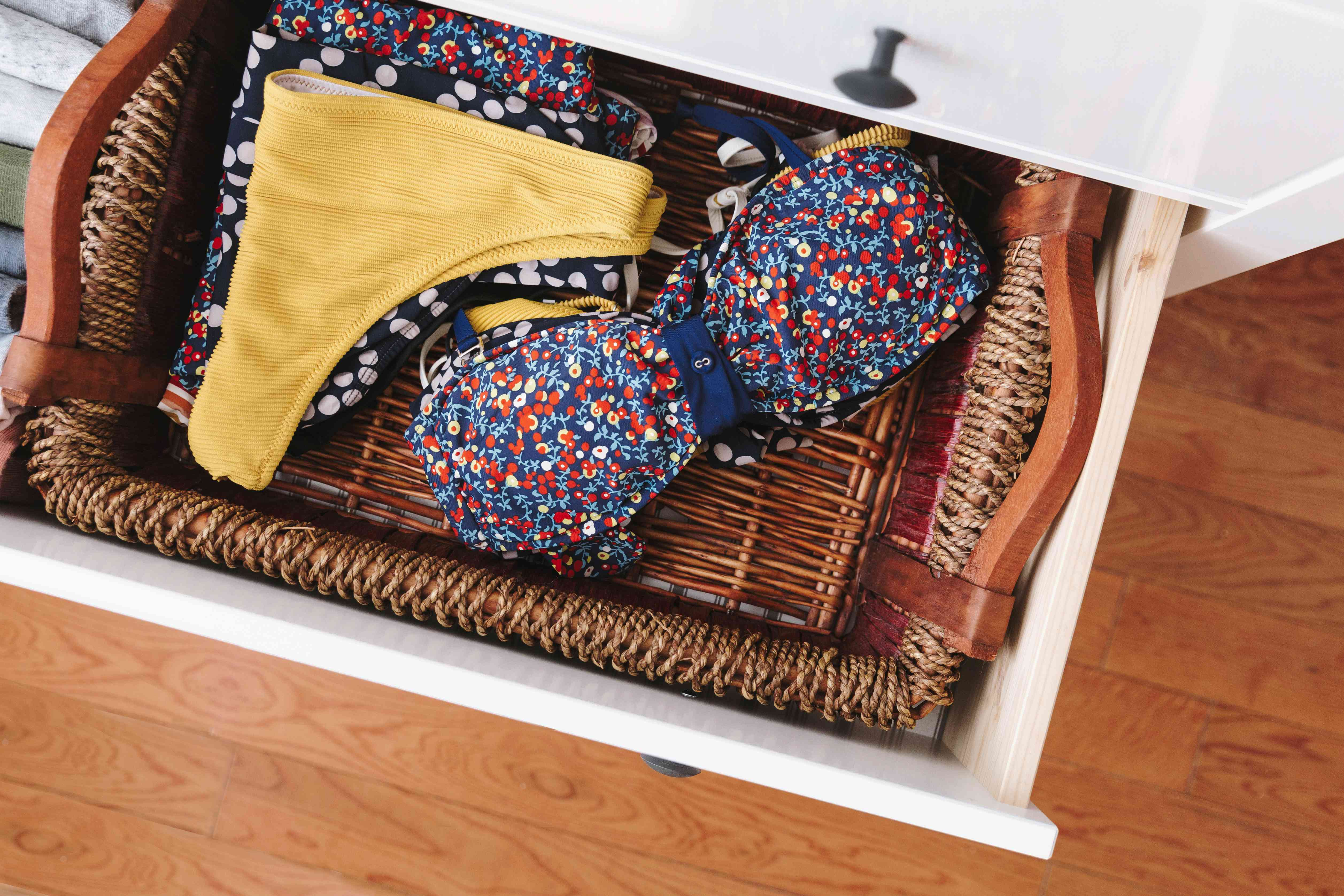 storing bathing suits in a basket within a drawer