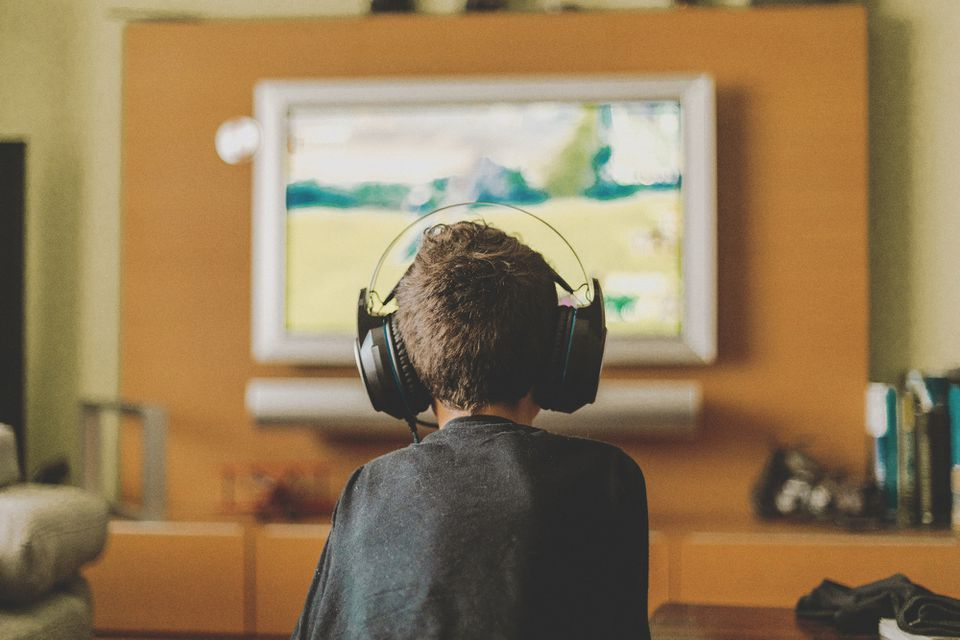 Kid playing video games