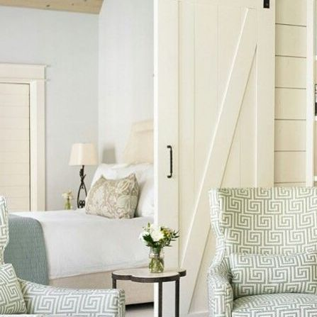 A room partitioned with a barn door