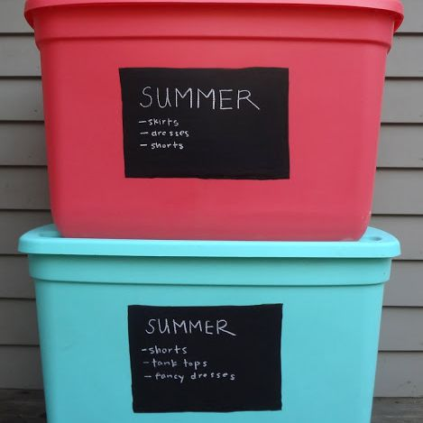 plastic storage bins labeled for summer clothes