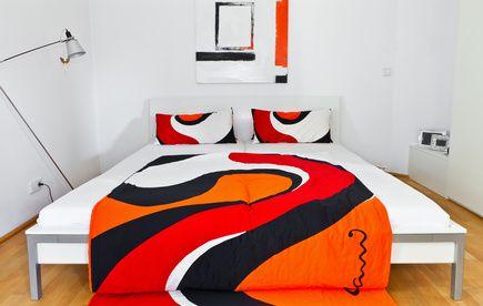 Bold Vibrant Orange And Dark Blue Modern Bedroom