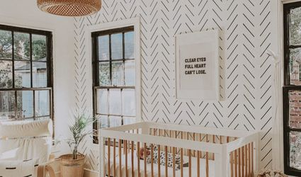 Black and white boho nursery with patterned accent wall