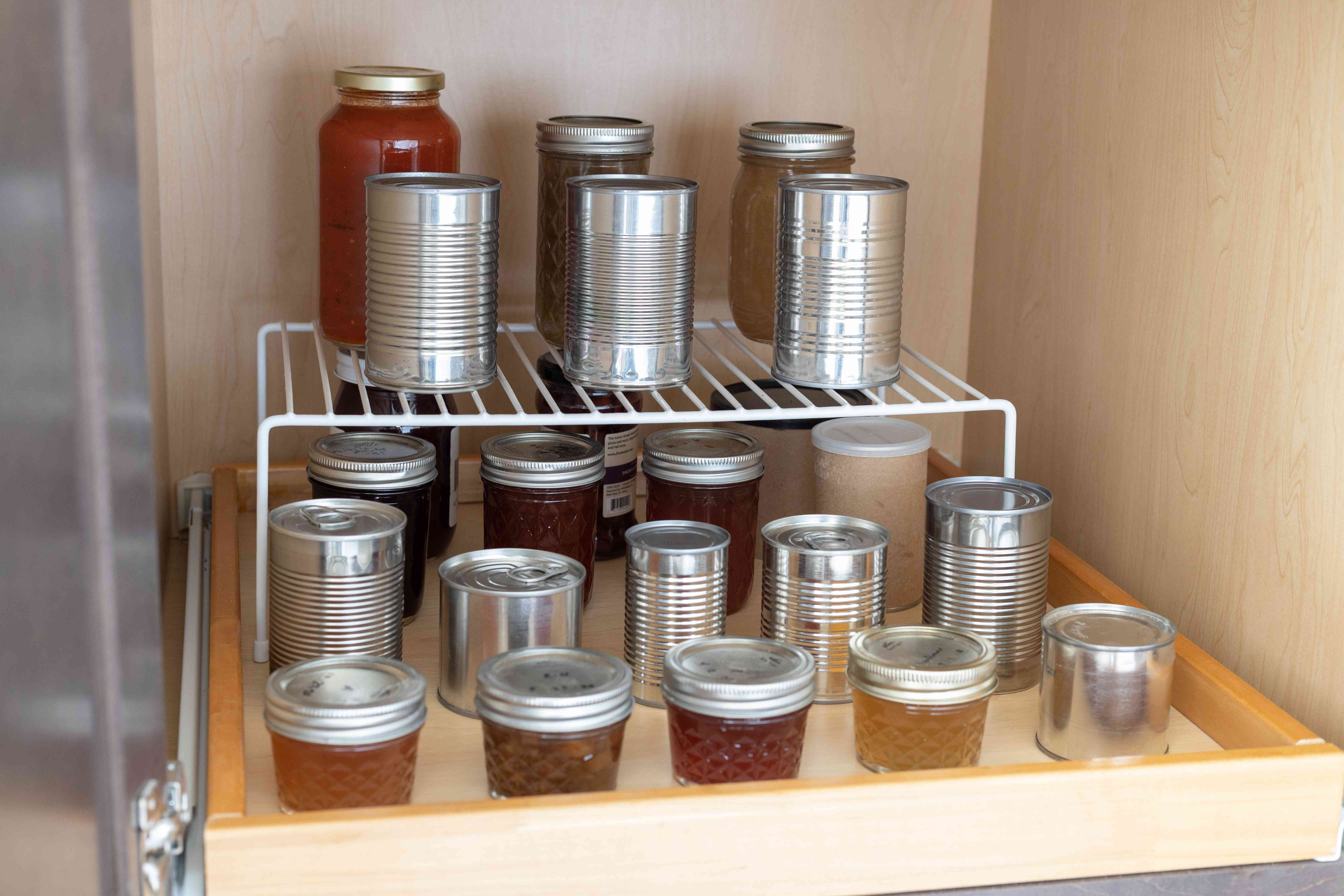 Kitchen pantry shelf with organized glass and containers with wire shelf